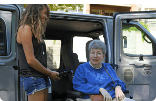 Caregiver helping patient in wheelchair